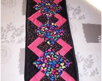 With butterflies and polka dots, pink, black and multicolor patchwork table runner