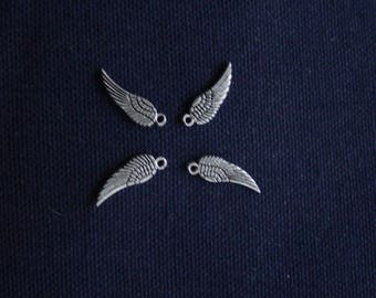 4 charms very small silver wings