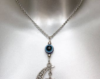 Moon and star necklace with evil eye