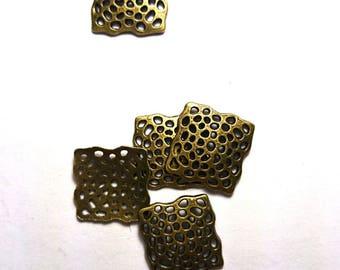 Copper colored square connectors