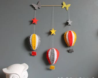 Mobile hot air balloons in red and yellow tones