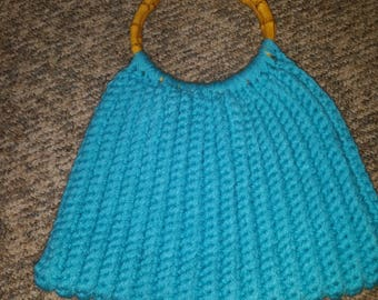 Crocheted turquoise lined purse with bamboo handles