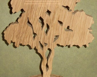 "WOODEN tree ""pin"" with its base to stick"