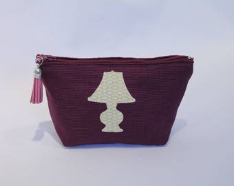School Kit or makeup plum on cotton canvas with a Lampa has yellow pattern