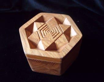 Beautiful hexagonal shaped handmade wooden box with geometric carved design