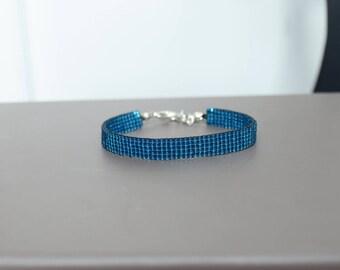 Bracelet woven with Miyuki Delica plain color blue zircon
