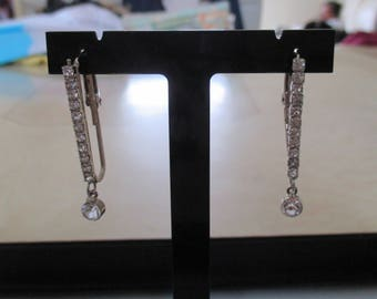 silver plated earrings and rhinestones