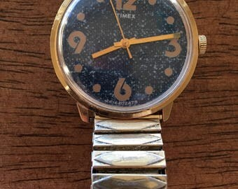 Timex vintage mens Denim dial /( rare) goldtone case  large gold numbers mechanical wind made 1978 watch
