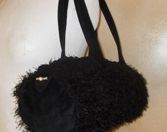 Bowling bag, faux fur, suede and swarovski crystal.