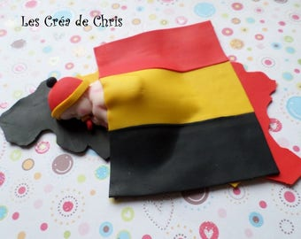 polymer clay baby asleep on the Belgium map.