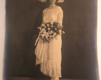 Nice 1920s era flapper photo woman in White dress holding flowers