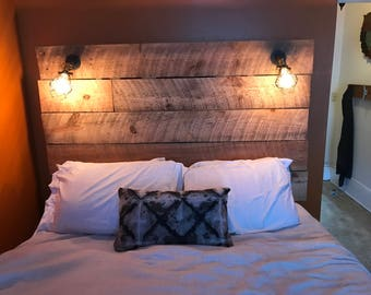 Reclaimed Wood Headboard with Industrial Lighting and Shelving