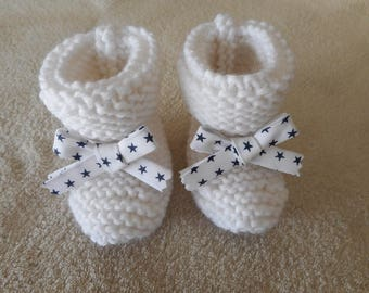 Navy Blue White Ribbon with stars and white wool baby booties.