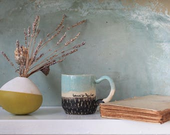 Handmade stoneware tea or coffee cup. Stoneware textured green water glaze speckled, etched black slip.