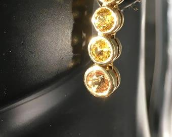 Natural yellow sapphire yellow 14 k gold bezel set earrings