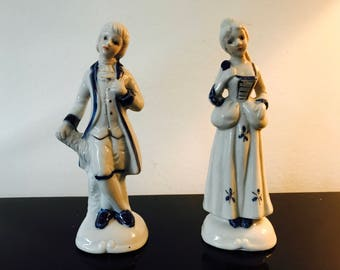 Pair of blue & white porcelain figurines