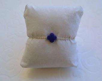 Royal Blue clover bracelet on silver chain.