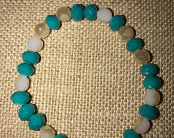 Teal and beige iridescent glass beaded bracelet