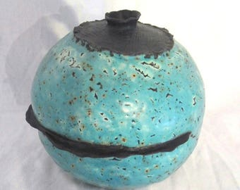 Turquoise and black earthenware round vase