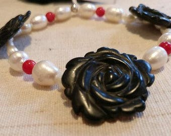Designer elastic bracelet with obsidian roses, coral and baroque beads