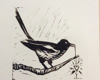 Original hand pulled linocut print of magpie with heart pendant.