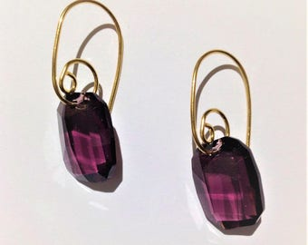 Spiral earrings adorned with a purple Crystal
