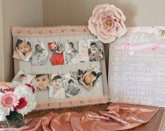 1st birthday milestone photo board; clothespin hanging photos