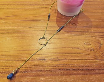 Necklace is gold and blue beads