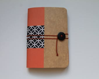 Orange and black notebook with white pattern