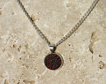 Necklace with red and black beads with silver chain.