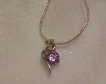 Silver plated lilac crystal necklace .