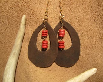 Dark brown leather large tear drop shaped with red wooden beads and gold plated findings.