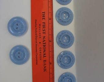 Seven blue plastic buttons