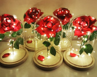 Enchanted red rose in a glass dome