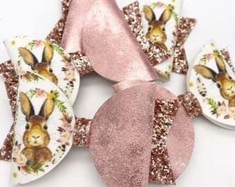 Some bunny loves me, artisan fabric & rose gold faux leather, glitter fabric hair bow. Hair clip, nylon headband. Spring easter bow  Dolly