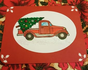 Red truck with green Christmas tree
