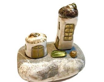Little beach houses, vitamin sea decoration. Tiny houses made with beach finds. Miniature island, shells, pebble, sea glass