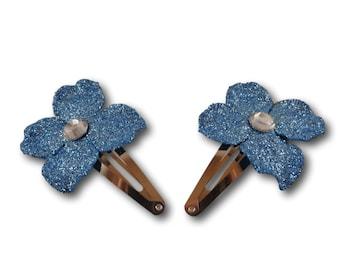 Bright blue sparkled hair clip with a diamond gem