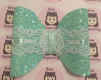 Aqua glitter and lace hair bow for girls, ideal for parties or weddings, bridesmaids