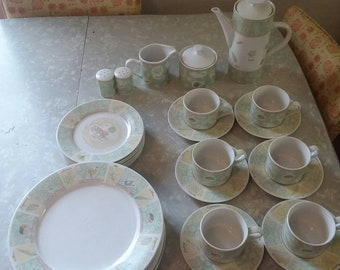 Vintage stoneware 6 place setting 31pcs. Includes dinner plates, lunch plates, coffee cups+saucers, salt+pepper, cream+sugar and kettle.