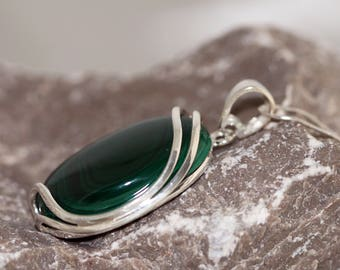Malachite Pendant. Stunning, dark green, oval-shaped stone in classic, sterling silver setting. Handmade & unique.