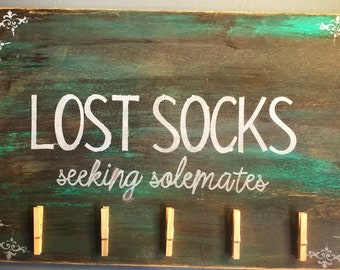 Wooden sign ,inspirational quote. Lost socks.