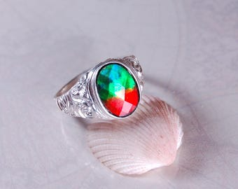 Ammolite Mens Ring.Powerful rainbow colours in a heavy and very popular sterling silver setting.#081127