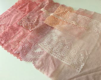 assortment of various smaller sheer lingerie tulle lace / mesh swatches — antique pink — different sizes and patterns