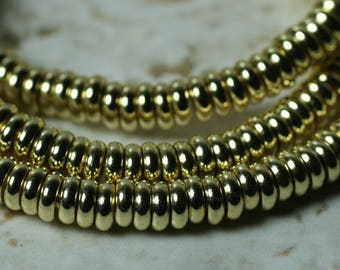 Gold tone rondelle beads aprox 4mm in diameter 1.5mm thick 2mm hole size, 12 pcs (item ID FA2464MB)