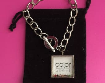 """Silver chain with white Color Street 7/8"""" square charm with a colored crystal row under jewelers grade epoxy ."""