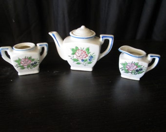 "Vintage porcelain 3 piece mini tea set with pink and blue flower pattern teapot measures 4"" x 1 1/2"" x 3"""