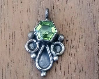 Peridot and sterling silver pendant