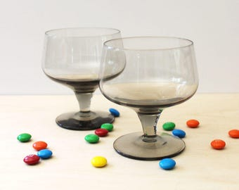 Mid century smoked footed sherry glasses, vintage barware.