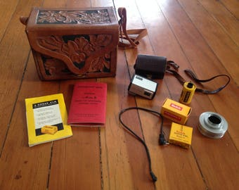 Vintage leather embossed flower Camera case with Kodak and Weston accessories bag